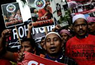 Ethnic Rohingya Muslim refugees shout slogans during a protest against the persecution of Rohingya Muslims in Myanmar, outside the Myanmar embassy in Kuala Lumpur on November 25, 2016