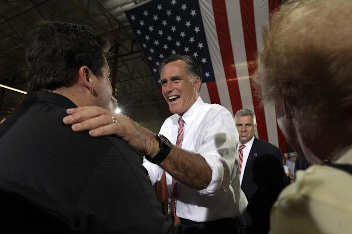 Republican presidential candidate, former Massachusetts Gov. Mitt Romney greets supporters after speaking at a campaign event at the Somers Furniture warehouse in Las Vegas Tuesday, May 29, 2012 in Las Vegas. (AP Photo/Mary Altaffer)