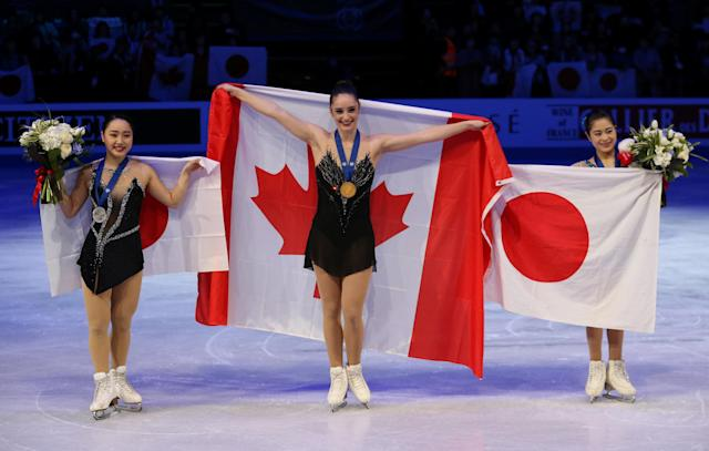 Figure Skating - World Figure Skating Championships - The Mediolanum Forum, Milan, Italy - March 23, 2018 Canada's gold medalist Kaetlyn Osmond (C), Japan's silver medalist Wakaba Higuchi (L) and Japan's bronze medalist Satoko Miyahara pose with their medals during the ceremony for the Ladies Free Skating REUTERS/Alessandro Bianchi