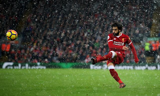 Mohamed Salah in action for Liverpool against Everton amid snow at Anfield in December.