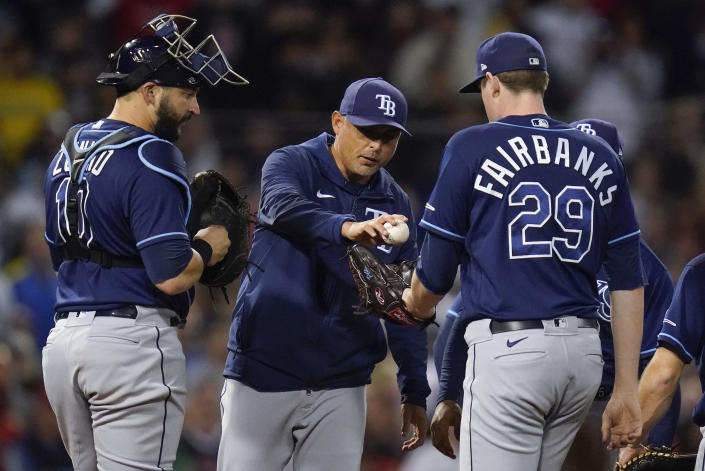 Tampa Bay Rays manager Kevin Cash hands the ball to pitcher Pete Fairbanks (29) during a pitching change in the seventh inning against the Boston Red Sox during Game 4 of a baseball American League Division Series, Monday, Oct. 11, 2021, in Boston. (AP Photo/Charles Krupa)