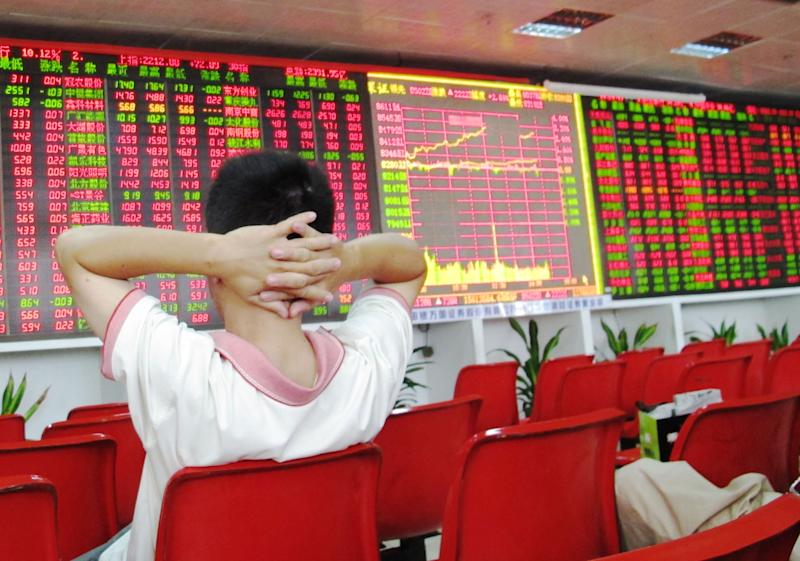 HAIKOU, CHINA - SEPTEMBER 09: (CHINA OUT) An investor watches the electronic board at a stock exchange hall on September 9, 2013 in Haikou, China. Chinese shares closed higher Monday with the benchmark Shanghai Composite Index climbed 3.39 percent, or 72.52 points, to close at 2,212.52 points. The Shenzhen Component Index gained 224.40 points, or 2.71 percent, to close at 8,504.74. (Photo by ChinaFotoPress/ChinaFotoPress via Getty Images)