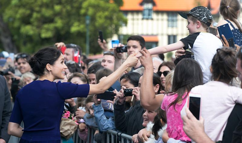 The Duchess of Sussex is used to charming crowds. (Photo: Pool via Getty Images)