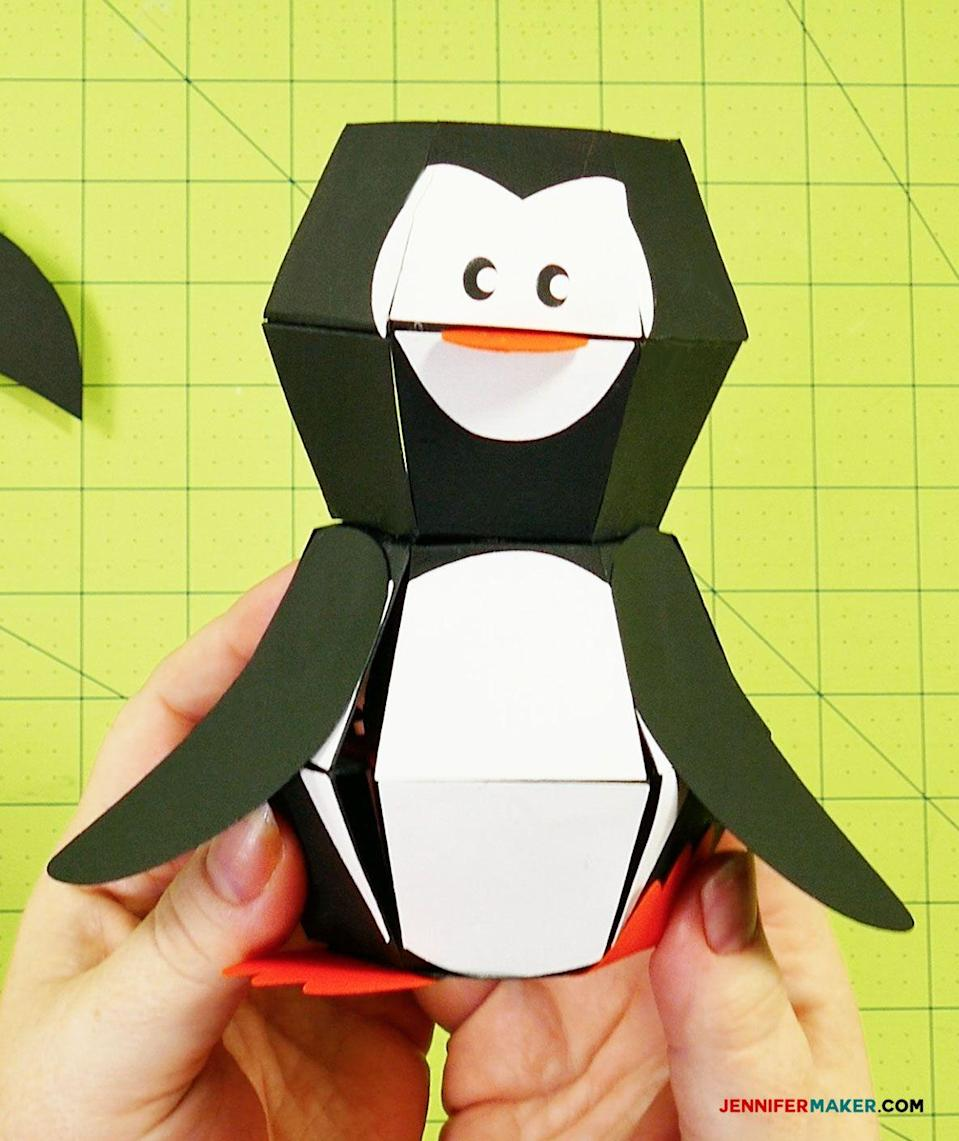 "<p>Here's a holiday paper craft that will truly wow the crowd. This paper penguin lays flat ... until you drop it onto a surface on its feet, and it pops up like magic. </p><p><em><a href=""https://jennifermaker.com/penguin-paper-bomb/"" rel=""nofollow noopener"" target=""_blank"" data-ylk=""slk:Get the tutorial at Jennifer Maker»"" class=""link rapid-noclick-resp"">Get the tutorial at Jennifer Maker»</a></em><br></p>"