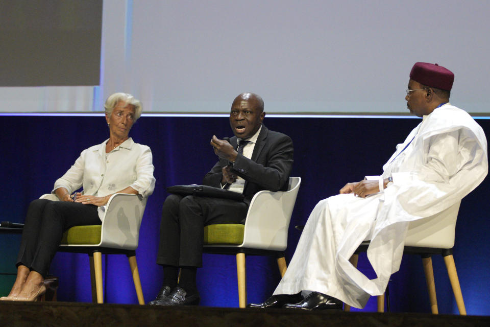 Gilbert Fossoun Houngbo, President of IFAD, center, with European Central Bank President Christine Lagarde, left, and former Niger president Mahamadou Issoufou, attend the IUCN World Conservation Congress, in Marseille, southern France, Friday Sept. 3, 2021. Macron is expected to urge the world to better protect biodiversity as key to fight climate change and support human welfare at a global summit starting Friday in southern France. (AP Photo/Daniel Cole)