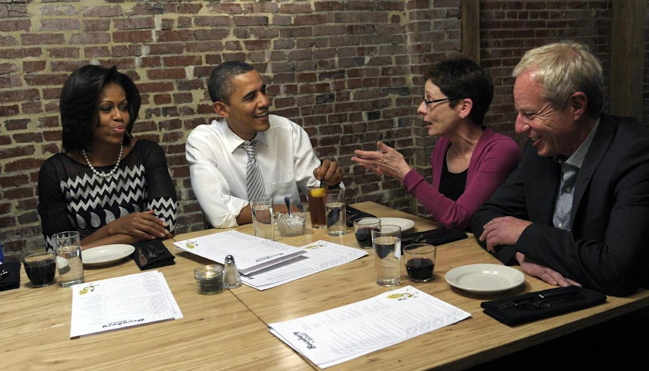 President Barack Obama and first lady Michelle Obama have dinner with grassroots supporters Judy Glassman, a retired school administrator from Cambridge, Mass., and Mitch Glassman, an artist from Cambridge, Mass., at Boundary Road Restaurant in Washington, Thursday, March 8, 2012. (AP Photo/Susan Walsh)
