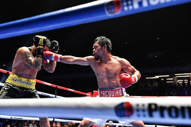 Philippines fighter Manny Pacquiao, shown right against Lucas Matthysse last July, will announce details of his next fight Monday in New York (AFP Photo/Mohd RASFAN)