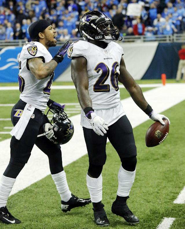 Baltimore Ravens free safety Matt Elam (26) walks off the field after intercepting a pass intended for Detroit Lions wide receiver Nate Burleson during the fourth quarter of an NFL football game in Detroit, Monday, Dec. 16, 2013. (AP Photo/Duane Burleson)