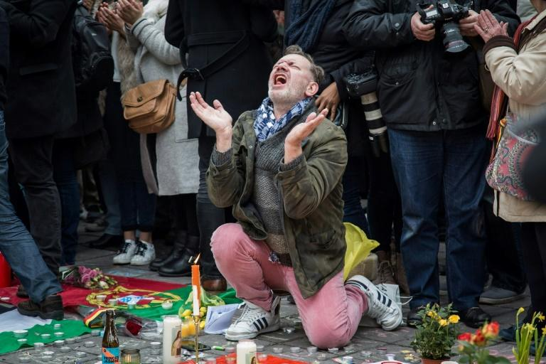 Grief-stricken Belgians had gathered at spontaneous memorials for the victims of last year's attacks
