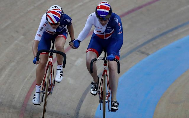 <span>Elinor Barker and Emily Nelson sling each other during the women's Madison final</span> <span>Credit: AP Photo/Vincent Yu </span>