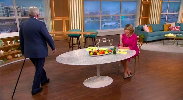Eamonn Holmes hobbled back onto screen using a stick. (ITV)