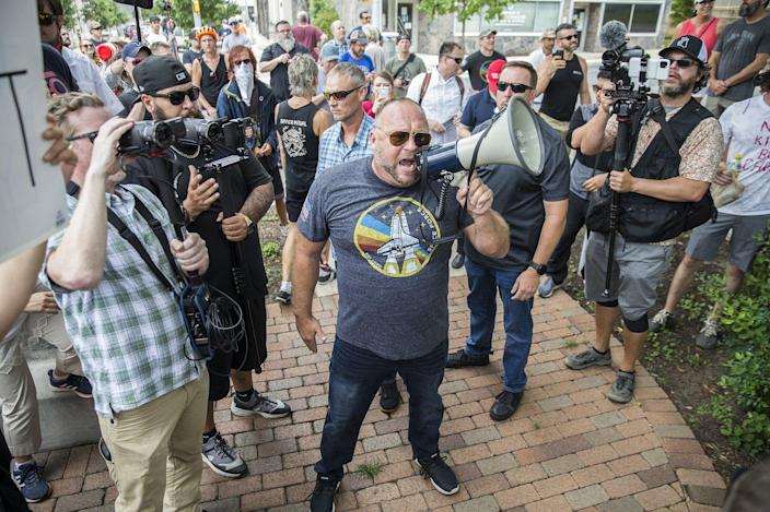 Info Wars founder Alex Jones joins nearly 150 anti-mask protesters.