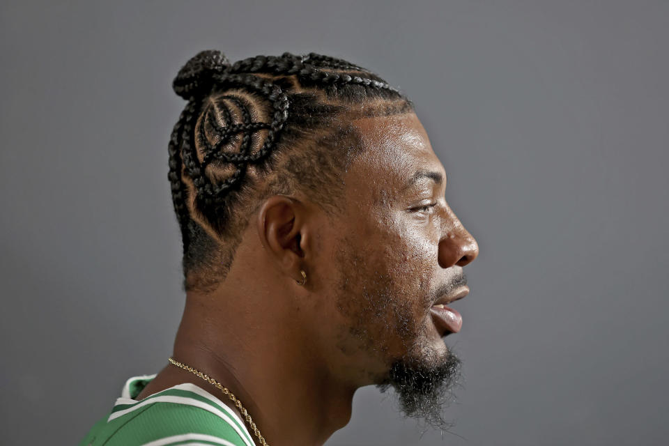 Boston Celtics guard Marcus Smart speaks during an interview during the Boston Celtics Media Day, Monday, Sept. 27, 2021, in Canton, Mass. (AP Photo/Mary Schwalm)
