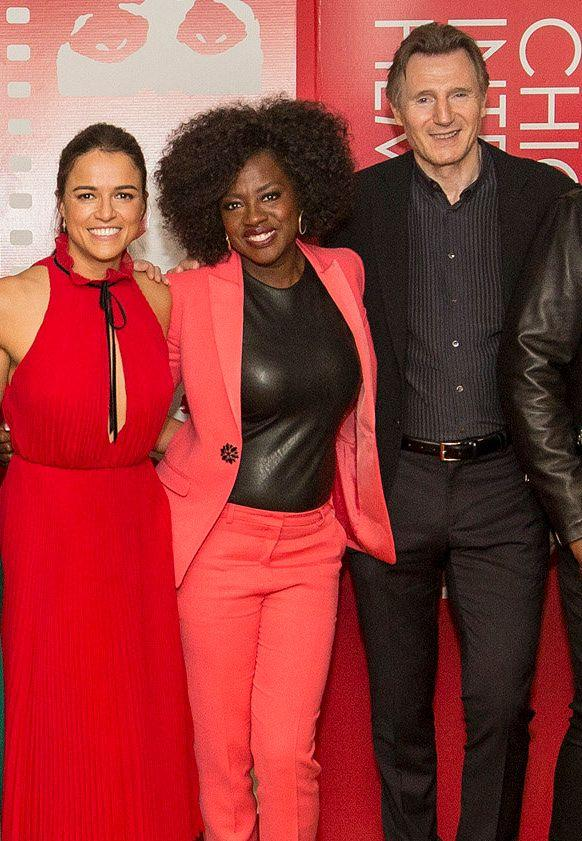 Michelle with Widows co-stars Viola Davis and Liam Neeson (Photo: Barry Brecheisen via Getty Images)