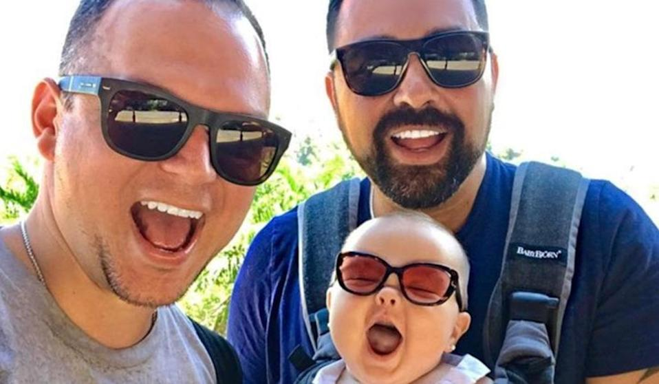 Dads Tommy and Rob with their daughter Mia [Photo: Instagram/gays_with_kids]
