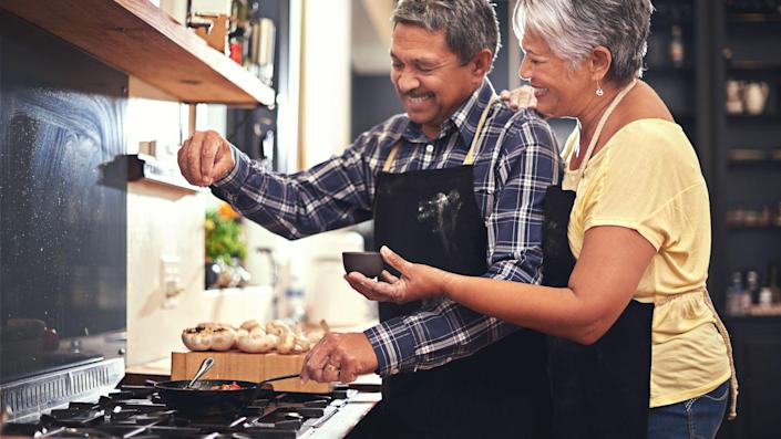 Shot of a happy senior couple cooking together at homehttp://195.