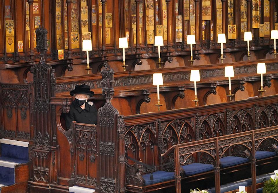 <p>The Queen sat alone at St George's Chapel </p> (PA Wire)