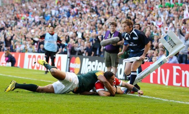 Japan's Karne Hesketh scores the winning try against South Africa in 2015