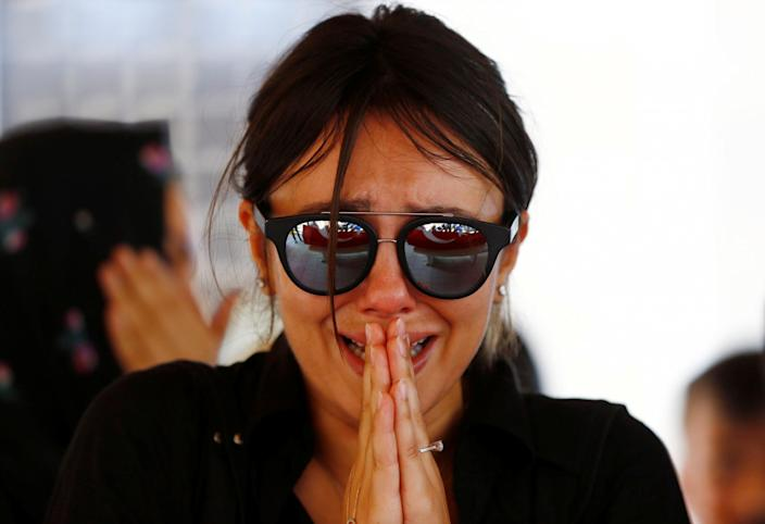 <p>A friend of Gulsen Bahadir, a victim of Tuesday's attack on Ataturk airport, mourns during her funeral ceremony in Istanbul, Turkey, June 29, 2016. (REUTERS/Osman Orsal) </p>