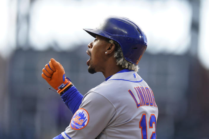 New York Mets' Francisco Lindor reacts after reaching first base on an RBI single off Colorado Rockies relief pitcher Daniel Bard during the seventh inning of a baseball game Saturday, April 17, 2021, in Denver. The Mets won 4-3 in the first game of a doubleheader. (AP Photo/David Zalubowski)