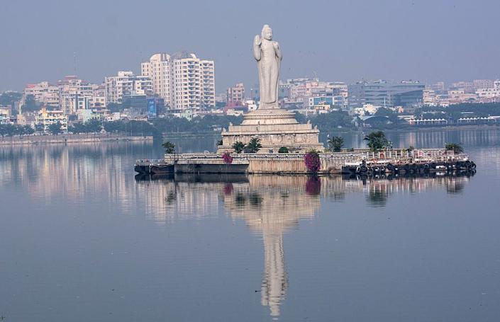 An 18 meter tall Buddha statue stands in the middle of Lake Hussain Sagar in Hyderabad.