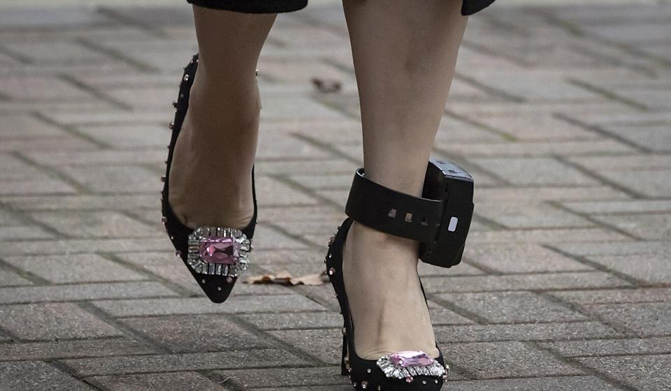 Meng's GPS ankle monitor, seen as she leaves her home to attend a hearing at British Columbia Supreme Court, in Vancouver on November 27, 2020. Photo: The Canadian Press via AP