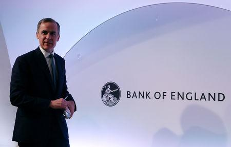 The Governor of the Bank of England, Mark Carney leaves after a news conference at the Bank of England in London