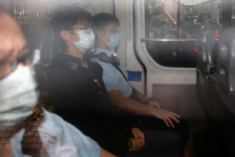 Former convenor of pro-independence group Studentlocalism, Tony Chung Hon-lam arrives at West Kowloon Magistrates' Courts in a police van after he was arrested under the national security law, in Hong Kong