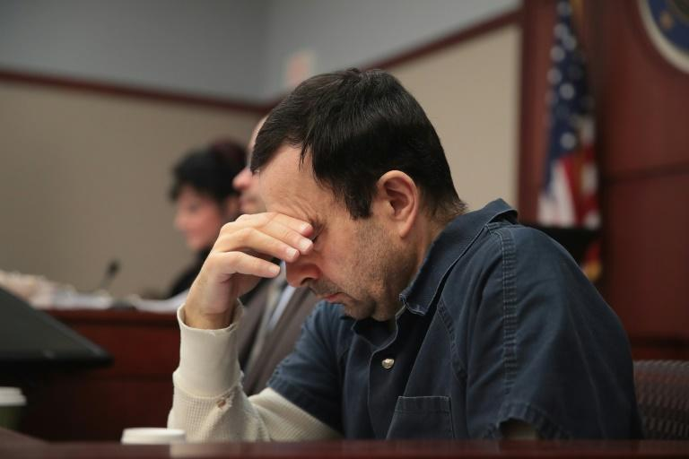 Larry Nassar listens to victim impact statements during his sentencing hearing on January 17, 2018 in Lansing, Michigan