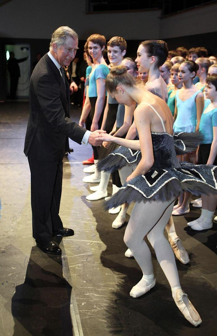<p>Prince Charles greets young dancers from the Elmhurst Ballet school during a visit to reopen Birmingham's town hall in 2008.</p>