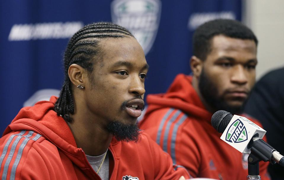 Northern Illinois wide receiver Da'Ron Brown addresses an NCAA college news conference in Detroit, Thursday, Dec. 4, 2014. Northern Illinois will meet Bowling Green in the Mid-American Conference Championship at Ford Field on Friday. (AP Photo/Carlos Osorio)