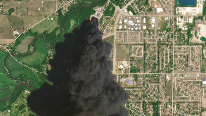 In this Satellite image provided by Planet Labs Inc., a huge plume of smoke and fires can be seen at the Chemtool Inc. plant near Rockton, Ill., on Monday, June 14, 2021. A private firefighting company from Louisiana was expected to begin pumping fire-suppressing foam Tuesday onto the still-burning ruins of a northern Illinois chemical plant, a day after it was rocked by an explosion and massive fires, officials said. (Planet Labs Inc. via AP)