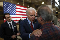 Democratic presidential candidate former Vice President Joe Biden, center, talks with a local resident during a community event, Wednesday, Oct. 16, 2019, in Davenport, Iowa. (AP Photo/Charlie Neibergall)