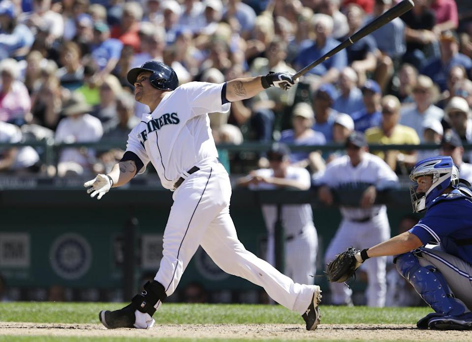 Seattle Mariners' Humberto Quintero, left, watches the path of his two-run home run with Toronto Blue Jays catcher DeMarlo Hale in the fifth inning of a baseball game on Wednesday, Aug. 7, 2013, in Seattle. (AP Photo/Elaine Thompson)