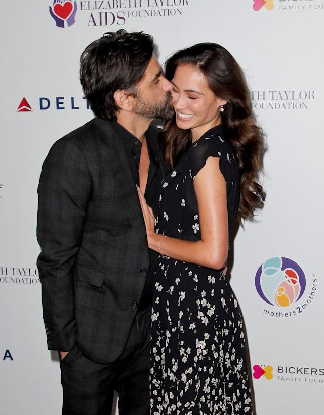 <p>Stamos and McHugh have been openly affectionate many times before. Days after announcing their engagement, they couldn't keep their hands (or lips) off each other at an October benefit dinner that mothers2mothers and the Elizabeth Taylor AIDS Foundation hosted in Beverly Hills. (Photo: Tibrina Hobson/Getty Images) </p>