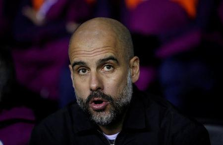 Man City's Pep Guardiola charged by FA for wearing yellow ribbon