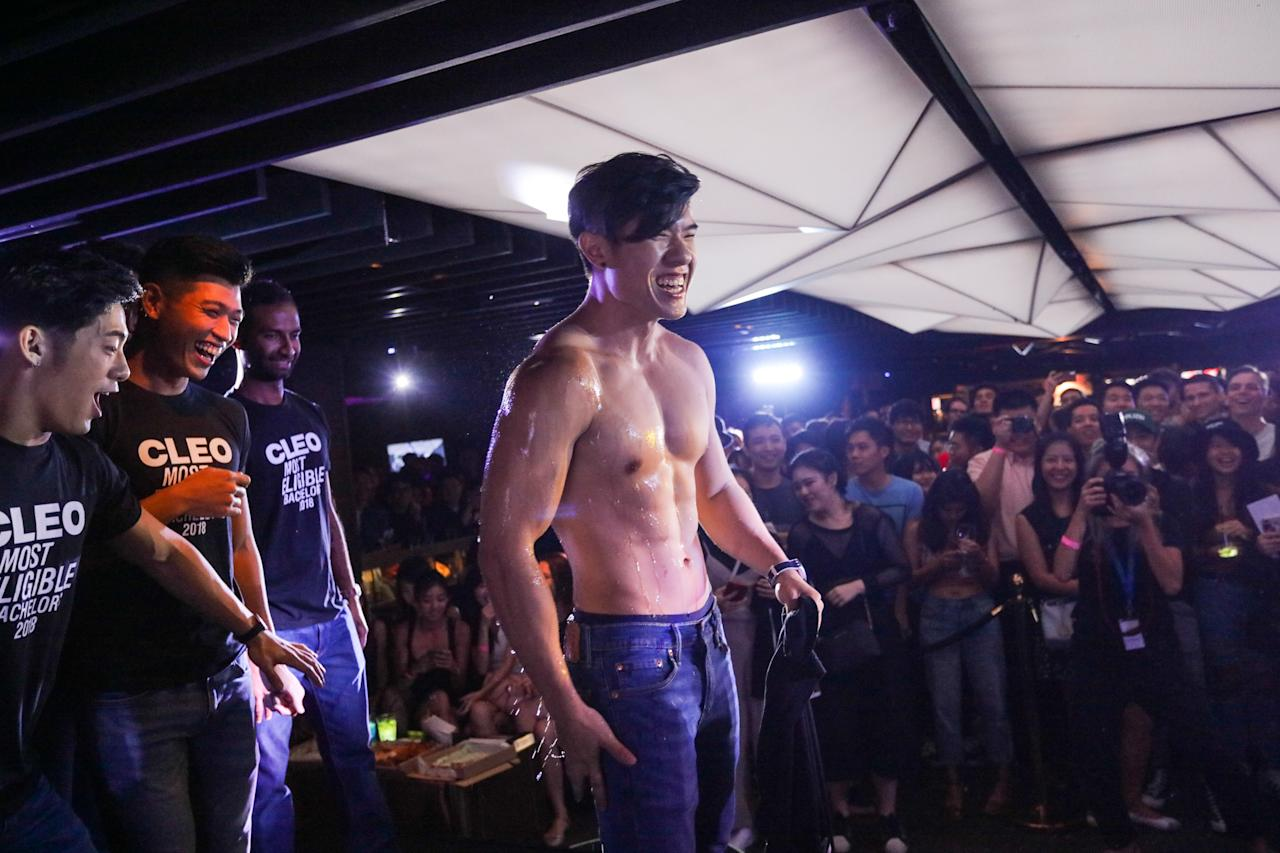 <p>SIM marketing student Ng Zi Xuan, 24, being doused with champagne by other bachelors shortly after being declared winner of CLEO Most Eligible Bachelors 2018 at Capital, Zouk at Clark Quay. (PHOTO: Don Wong) </p>