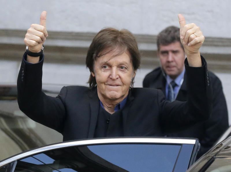 FILE - In this Monday, Oct.1, 2012 file photo Sir Paul McCartney gestures after the presentation of his daughter British fashion designer Stella McCartney's ready to wear Spring-Summer 2013 collection, in Paris. McCartney remains Britain's wealthiest musician, according to the Sunday Times Rich List. The newspaper estimated Thursday April 11, 2013 that the ex-Beatle shares a 680 million pound ($1.05 billion) fortune with his third wife, Nancy Shevell, whose family owns a U.S. trucking company. McCartney has topped the musicians' list every year since it was first compiled in 1989.(AP Photo/Michel Euler, File)