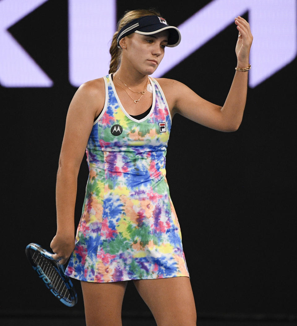 United States' Sofia Kenin reacts after losing a point to Spain's Garbine Muguruza during a tuneup event ahead of the Australian Open tennis championships in Melbourne, Australia, Friday, Feb. 5, 2021.(AP Photo/Andy Brownbill)