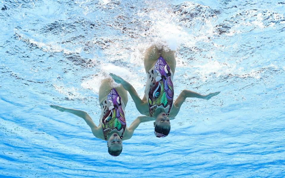 Team Italy perform in the artistic swimming event - GETTY IMAGES