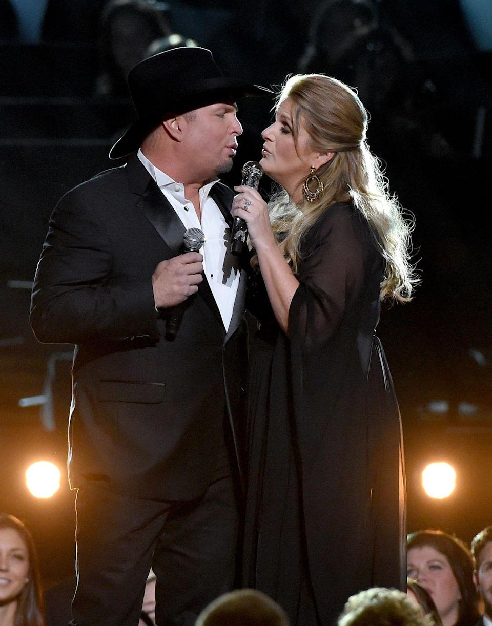 """<p><a href=""""https://www.goodhousekeeping.com/life/entertainment/a31980319/garth-brooks-wife-trisha-yearwood-proposal-carrie-underwood/"""" rel=""""nofollow noopener"""" target=""""_blank"""" data-ylk=""""slk:Garth Brooks"""" class=""""link rapid-noclick-resp"""">Garth Brooks</a> debuted this <a href=""""https://www.usatoday.com/story/life/music/2018/11/14/cmas-garth-brooks-emotional-new-song-trisha-yearwood-pray-god-takes-me-first/2008854002/"""" rel=""""nofollow noopener"""" target=""""_blank"""" data-ylk=""""slk:sweet tearjerker about his wife"""" class=""""link rapid-noclick-resp"""">sweet tearjerker about his wife</a>, Trisha Yearwood, at the 2018 CMA Awards. She was sitting front and center as he sang about all the ways she's been his stronger half <a href=""""https://www.goodhousekeeping.com/life/entertainment/a30337677/garth-brooks-wife-trisha-yearwood-marriage-secret/"""" rel=""""nofollow noopener"""" target=""""_blank"""" data-ylk=""""slk:during their 15-year marriage"""" class=""""link rapid-noclick-resp"""">during their 15-year marriage</a>. </p>"""