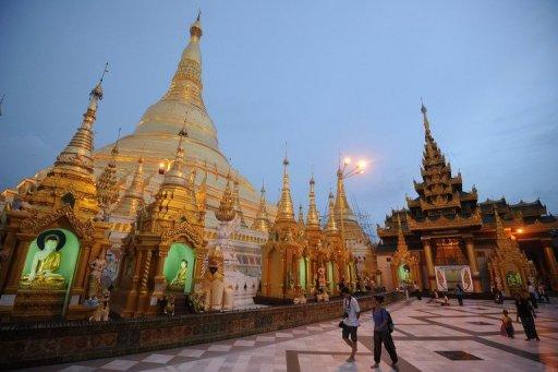 Western tourists are seen visiting the Shwedagon Pagoda in Yangon. The hotels are full or eye-wateringly expensive, creased dollar bills are worthless and credit cards are widely refused -- welcome to Myanmar, Asia's next big tourist destination