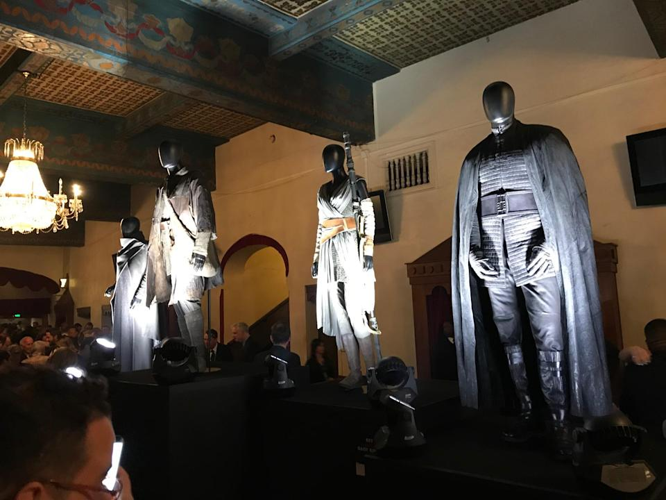 Among the screen-worn outfits displayed in the entrance of the Shrine Auditorium were those worn by Leia, left, Luke, Rey, and Kylo. (Photo: Marcus Errico/Yahoo)