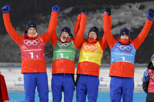 The team from Norway celebrate their silver medal during venue ceremony after the men's 4×7.5-kilometer biathlon relay at the 2018 Winter Olympics in Pyeongchang, South Korea, Friday, Feb. 23, 2018. They are (L-R) Lars Helge Birkeland, Tarjei Boe, Johannes Thingnes Boe and Emil Hegle Svendsen.(AP Photo/Gregorio Borgia)