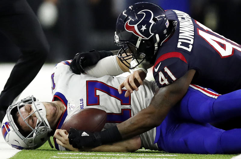 HOUSTON, TEXAS - JANUARY 04: Quarterback Josh Allen #17 of the Buffalo Bills is tackled by inside linebacker Zach Cunningham #41 of the Houston Texans during the AFC Wild Card Playoff game at NRG Stadium on January 04, 2020 in Houston, Texas. (Photo by Tim Warner/Getty Images)