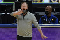 Milwaukee Bucks head coach Mike Budenholzer gestures during the first half of his team's NBA basketball game against the Golden State Warriors in San Francisco, Tuesday, April 6, 2021. (AP Photo/Jeff Chiu)