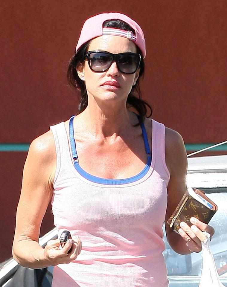 """Former supermodel Janice Dickinson looked a tad surly upon arriving at her gym in a pink tank top and matching cap. Sinister-Walsh/<a href=""""http://www.x17online.com"""" target=""""new"""">X17 Online</a> - May 4, 2010"""