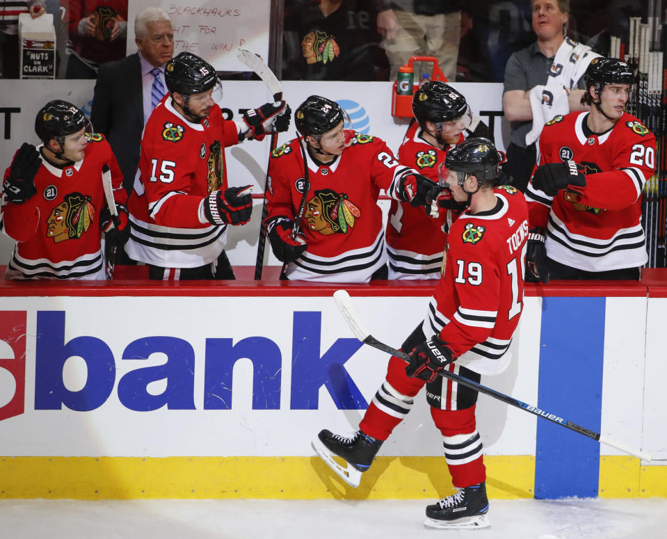 Chicago Blackhawks center Jonathan Toews celebrates with teammates after scoring against the Nashville Predators during the second period of an NHL hockey game Wednesday, Jan. 9, 2019, in Chicago. (AP Photo/Kamil Krzaczynski)
