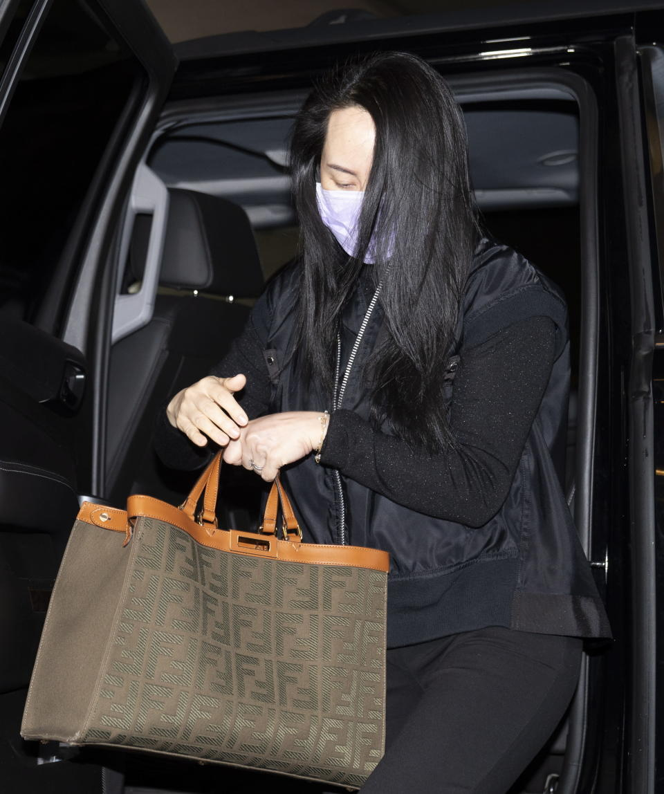 Chief Financial Officer of Huawei, Meng Wanzhou arrives at the British Columbia Supreme Court on Friday, Jan. 29, 2021, in Vancouver, British Columbia. (Jonathan Hayward/The Canadian Press via AP)