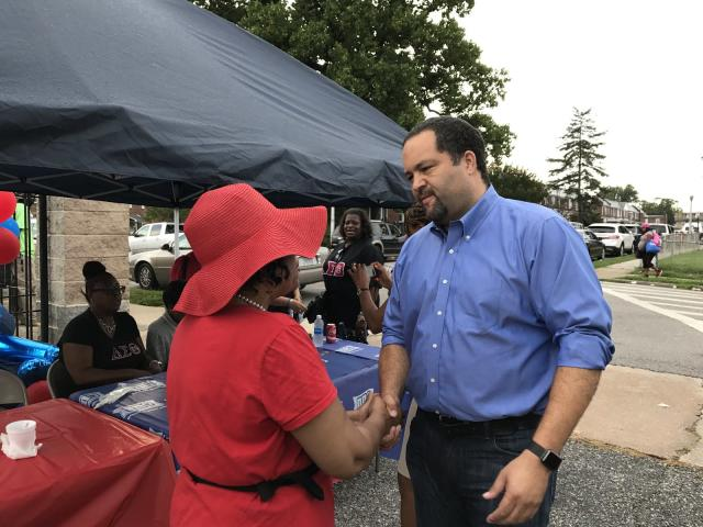 Ben Jealous speaks with a voter at an event in West Baltimore. (Photo: Andrew Bahl/Yahoo News)